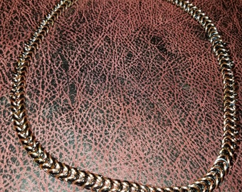 Chainmail jewelry necklace.  Bronze and black box weave.