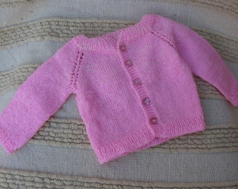 Hand knitted sweater for a baby girl
