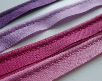 2mm flanged insertion piping on a 9mm band, shades of Pink, Lilac, and Purple - sold by the metre
