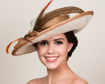 "Kentucky Derby Hat. Ivory Sinamay with Golden Bronze Trim. Natural Brown Orange Pheasant Feathers. 5"" Wide Asymmetrical Tilt Brim."
