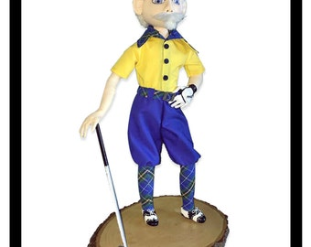 """Mulligan is a pattern for a 17.5"""" fabric doll with needle sculpted face and hands, and clay shoes and putter."""
