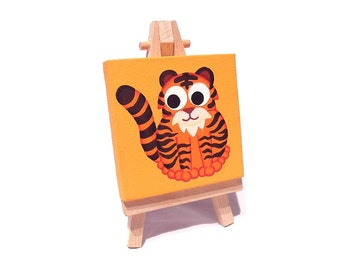 Tiger Art on Mini Canvas with Easel - original acrylic miniature painting of a cute cartoon tiger. Big cat artwork by Kim Onyskiw