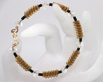 Hand twisted wire bangle with crystal beads. Fits a 7 - 8 inch wrist