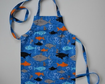 Toddler/boy's apron, print with sharks,  gift idea, apron with pocket, schools of sharks, stocking stuffer, adjustable apron, sizes 1 to 8.