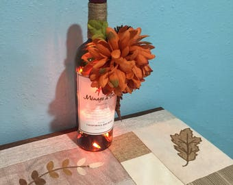 Handmade Recycled Wine bottle light ~ 20 count orange string lights ~ Fall Flowers ~ Thanksgiving ~ home decor ~ plugs in ~ great gift ideas