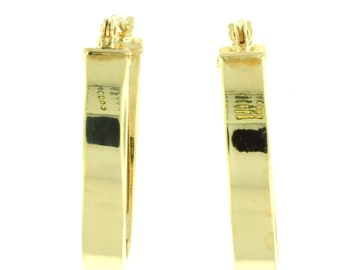 A pair of 14k yellow gold flat oval hoop earrings