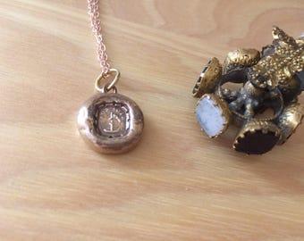 "Wax seal pendant ""bon soir"" with candle"