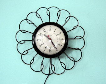 Late 50's Early 60's Black Metal Electric Retro Atomic Wall Clock USA