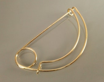 Brooch arch of a circle metal golden color