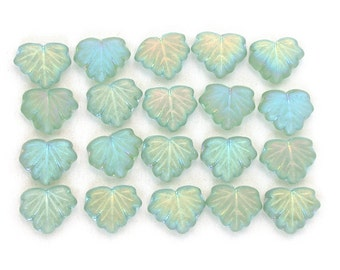 Soft Green transparent matte w/ AB finish 13 x 11mm maple leaves. Set of 10, 20 or 40 beads.