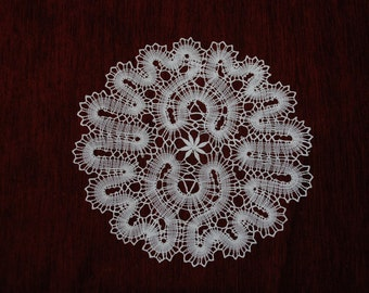 A large Russian bobbin lace round doily