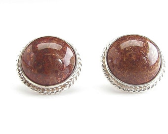 Silver Argentium earring with twisted bezels.