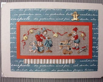 Embroidered picture of children playing with old toys