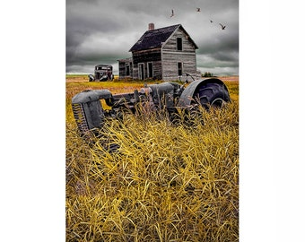 Abandoned Small Prairie Farm with rusted Tractor and Auto by Old Farm House - A Landscape Photograph