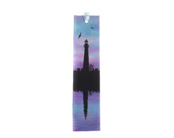 Handmade paper bookmark hand-painted on both sides with a lighthouse and a sailboat