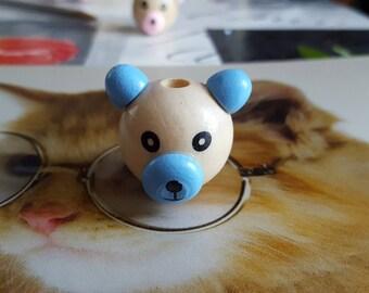 1 wooden bear head bead.