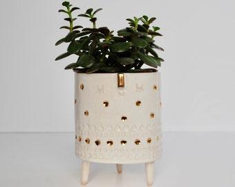 White tripod planter pot with gold dots