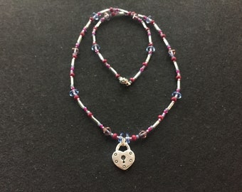 Purple and periwinkle bead necklace with heart lock charm