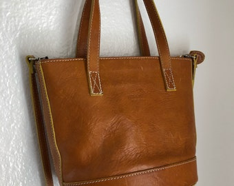 Vera crossbody or top handle bag. Bucket style, small. Near perfect condition, mauve suede lining. A beautiful bag!