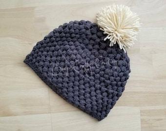 Crochet puff stitch pom pom hat