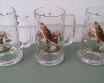A Vintage Set Of 3, Large Mouth Bass And Flying Geese, Clear Glass Beer Mugs
