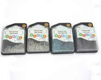 color glass beads 3mm, 4 boxes 2 Aurora, 1 sky blue, 1 Purple