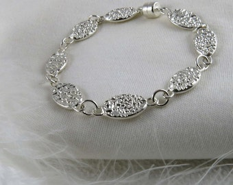 Sterling silver bracelet with textured ovals