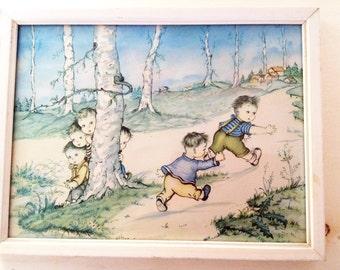 Vintage 1950s framed print of children playing hide and seek