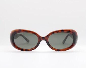 90s vintage sunglasses. Oval tortoise coloured frame with green lenses. 60's style design. Original NOS. BNWT. Club kids. Rave. Mod.