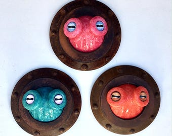 Octopus Eyes porthole sculpture, companion piece for small tentacle sculpture