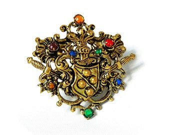 Czechoslovakia signed vintage / antique   gold tone crest brooch.