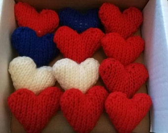 Pack of twelve hand knit hearts for weddings.
