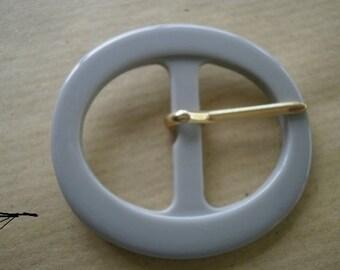 Plastic gray oval belt buckle, size 40 x 36 mm