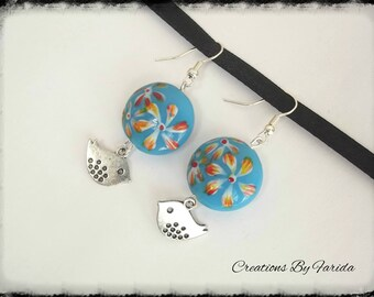 Blue domed round bead with a bird charm earrings