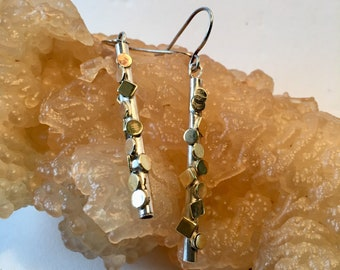 Silver tube with splashes of brass squares and discs earrings