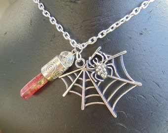 spider web necklace with red crystal