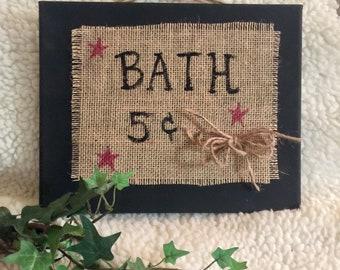 Bathroom primitive art with burlap and jute