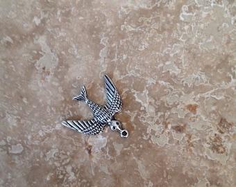 Bird in flight pendant