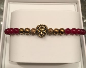 Burgandy and gold bracelet with gold lion head accent.