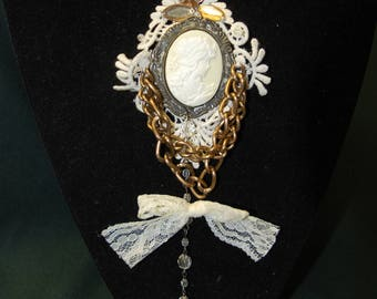 Brooch cameo on lace