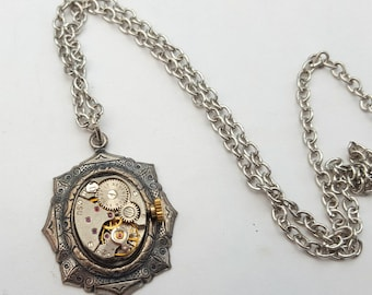 Steampunk necklace, vintage watch movement in antique silver setting on antique silver chain