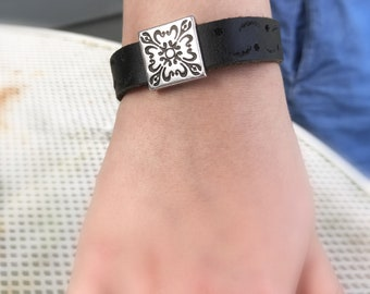 Black leather bracelet with silver floral concho ornament