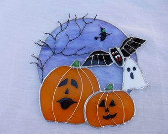 stained glass halloween moon with pumpkins, bat, witch,ghost