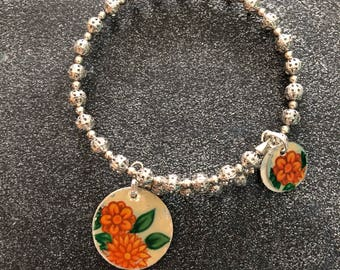 Silver Memory Wire Beaded Bracelet with Reclaimed Orange Floral Tin