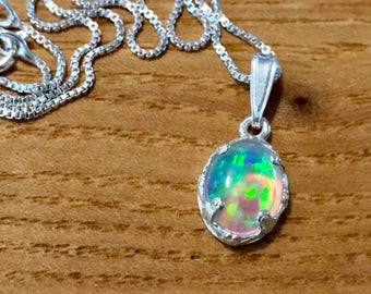 Crystal Opal necklace w/ AMAZING play of color, astonishing flash. 8x10mm gem. Lab-cultured opal in finely etched .925 sterling silver bezel