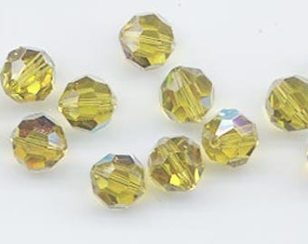 Twelve Swarovski crystals: art 5000 - 8 mm - lime AB