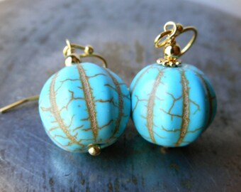 Turquoise stone earrings, gold plated, large carved howlite stone pumpkin bead, big turquoise gemstone earrings, sky blue dangle earrings