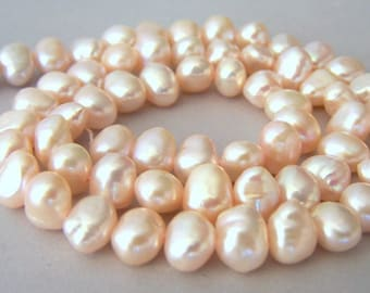 Pale peachy pink freshwater pearls, 10mm x 6mm, full strand, champagne, Silk color