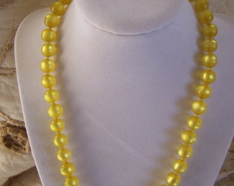 """Vintage 50's Lucite  """"MOON GLOW BEADS Necklace"""" in a Yellow / Golden Color"""