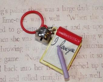 Jahrgang Bell Charme Hinweis Pad Bleistift Notebook ich liebe dich - Charme-Armband - Kette - Retro Schlüsselanhänger-Clip - Reißverschluss ziehen - Kitsch Kawaii - 80er Jahre